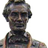 Image: Statuette of Lincoln standing and holding the Emancipation Proclamation in his hands
